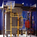 View of a detailed engineering scale model of an industrial process featuring color-coded piping systems