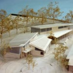 View of a basswood architectural scale model for a new structure at The Community School in Sun Valley, Idaho, their Trail Creek Campus Science Building designed by Malhum Architects showing surrounding foliage