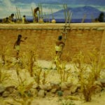 Detail of activity around the wall of the museum scale model of the Tusayan Pueblo
