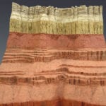Detail view of the Grand Canyon Geologic Column scale model showing multi-color layers of stone