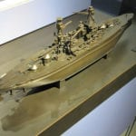 A full view from above the stern of the bronze museum scale model of the battleship Arizona at the Valor in the Pacific National Monument in Pearl Harbor, Hawaii