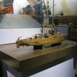 A full view of the display area, showing the bronze museum scale model of the battleship Arizona at the Valor in the Pacific National Monument in Pearl Harbor, Hawaii