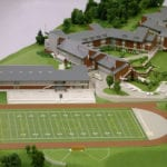 Detail view of the playing field and surrounding buildings, part of the architectural scale model of Eastside Catholic High School created for Integrus Architecture