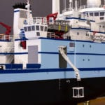 A view from amidships of the engineering scale model of the RV Sikuliaq showing a crane operation