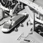 Detail view from above of an engineering scale model of the West Seattle Bridge and the Spokane Street drawbridge showing a cargo ship passing under the drawbridge